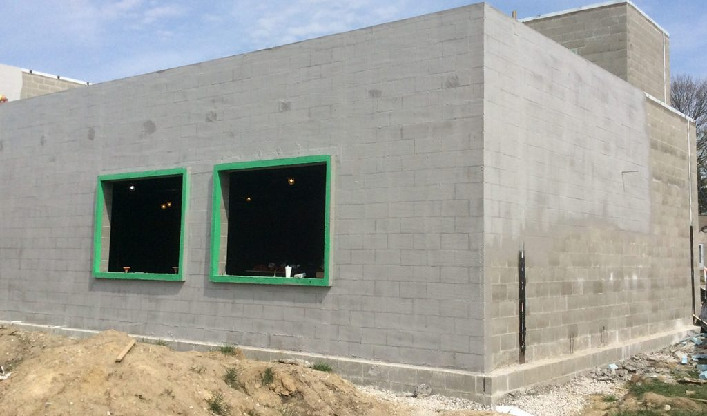 Building with fluid applied system. The insulation products are applied as a spray.