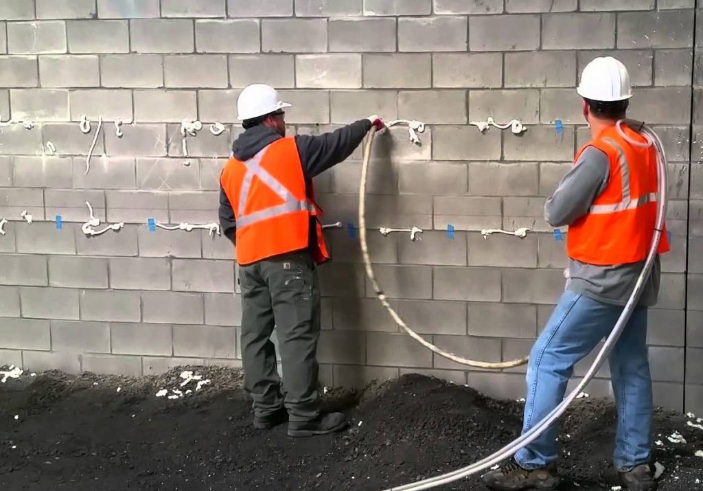 Cavity Fill-two Superior Instealators installers injecting foam into the cavities.