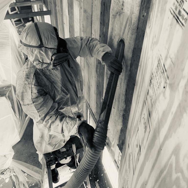 Expert technician installing spray foam